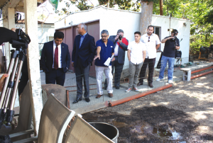 "Broken Pipes Create Backyard ""Jacuzzi""-  Assemblyman Jimmy Gomez [right]and State Senator Roger Hernandez [second from right] inspect the back yard of a home owned by Caltrans where a broken pipe has created what area neighbors refer to as the ""Jacuzzi.""  Randy Economy Photo."